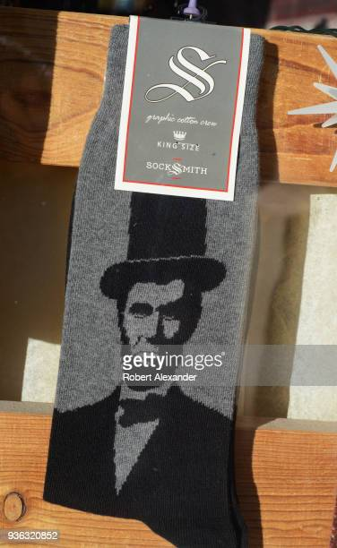 A shop window display in Santa Fe New Mexico features novelty socks for sale including a pair with a likeness of former President Abraham...