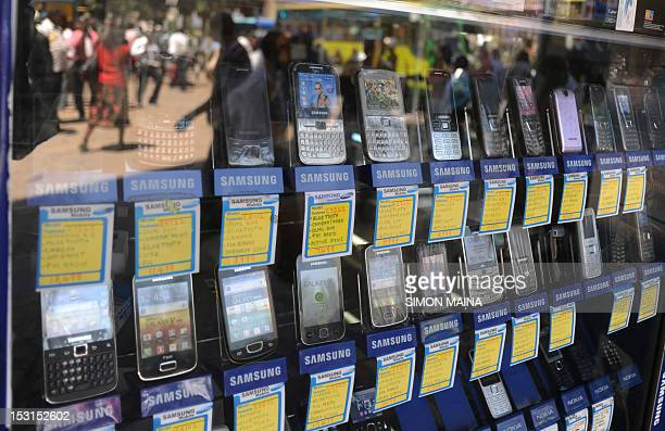 A shop window displays mobile phones on October 12012 in Nairobi as Kenya confirmed a switchoff of counterfeit mobiles will take place at the end of...