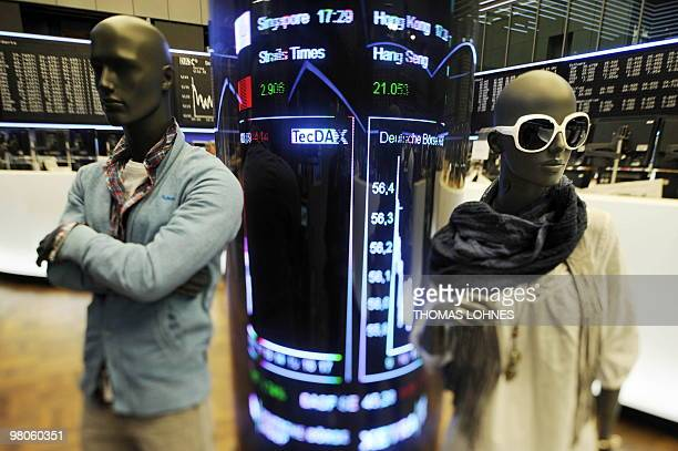 10f9e93331dde8 Shop window dummies of the German fashion company Tom Tailor stand at the Frankfurt  stock exchange