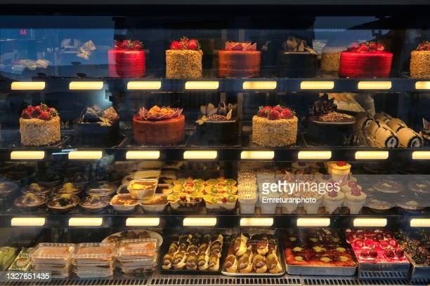 shop window full of sweet food variety in cesme. - emreturanphoto stock pictures, royalty-free photos & images