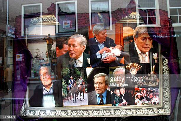A shop window is shown decorated with portraits of Prince Claus October 13 2002 in Delft The Netherlands Prince Claus husband to Queen Beatrix died...