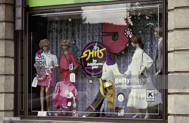 Shop window of a boutique in Eastern Berlin and 35 Jahre DDR and Hits im Jubilaeumsjahr buttons