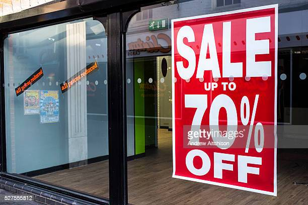 Shop window of an empty retail unit in Middlesborough town centre North Yorkshire United Kingdom The windows still have the sale signs on display...
