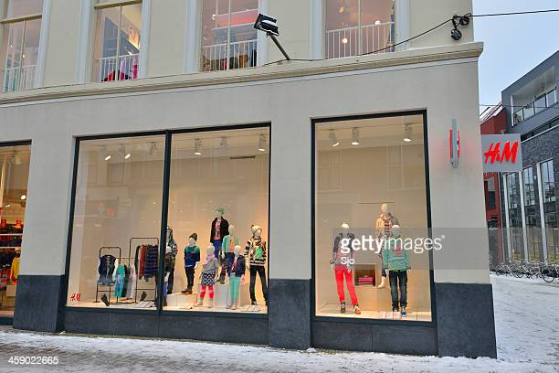 h&m shop window - modern essentials by h&m stock pictures, royalty-free photos & images