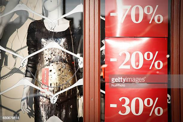 Shop window with ads for discounts is seen on December 30, 2016 in Bydgoszcz, Poland. Bydgoszcz is the eighth-largest city in Poland.