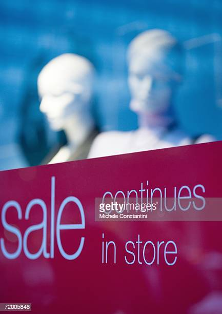 shop window with sign saying sale continues in store - typographies stock photos and pictures