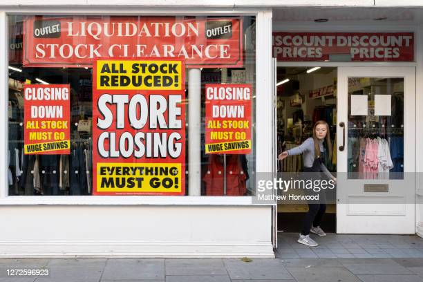 Shop worker closes the door of a shop that is shutting down on September 14, 2020 in Newport, Wales. First Minister of Wales Mark Drakeford has...