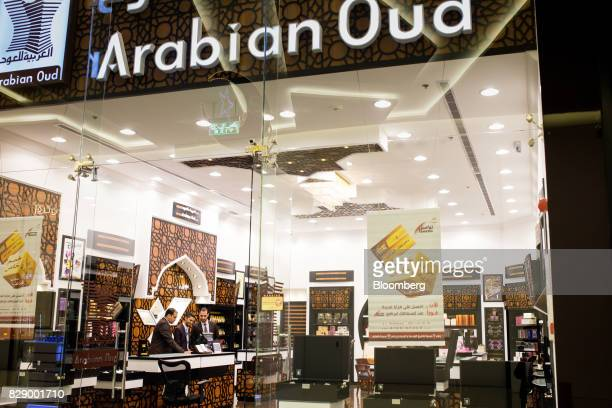 Shop workers wait for customers in an empty Arabian Oud perfume store at the Al Yasmin mall in Jeddah Saudi Arabia on Sunday Aug 6 2017 After relying...