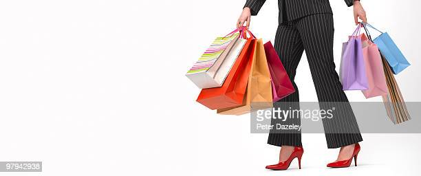 Shopaholic teenager with shopping bags