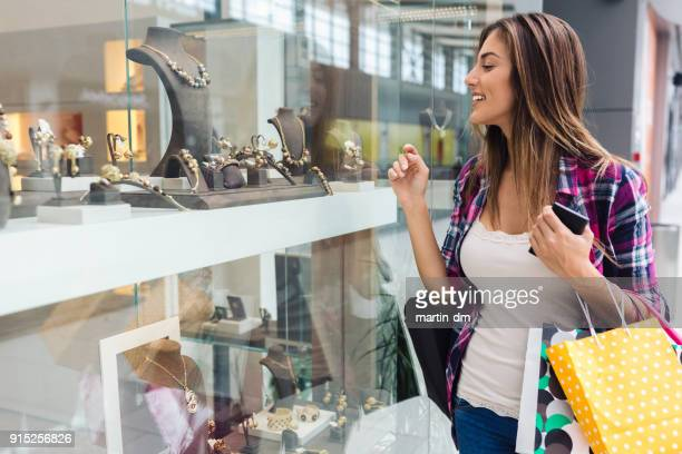 shopaholic woman in the shopping center - jewellery stock pictures, royalty-free photos & images
