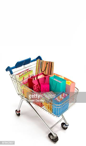 Shopaholics shopping in supermarket trolley