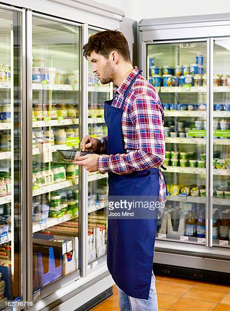 shopassistant using digital tablet in supermarket
