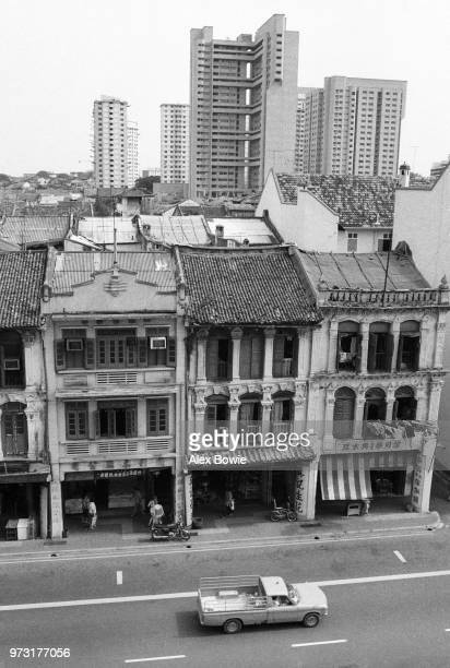 Shophouses on Upper Cross St seen before their residents are relocated in September 1983 and before being restored following conservation status in...