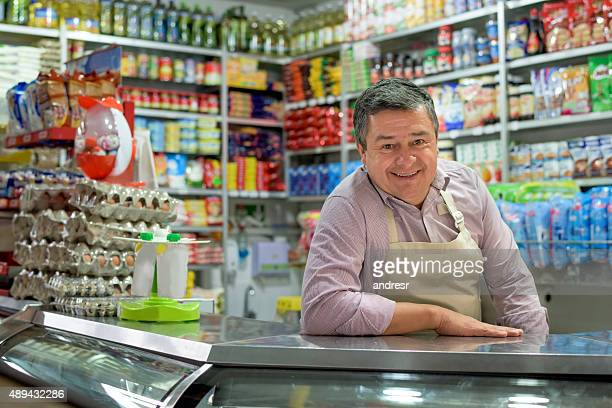 shopkeeper at a local food shop - happy merchant stock pictures, royalty-free photos & images