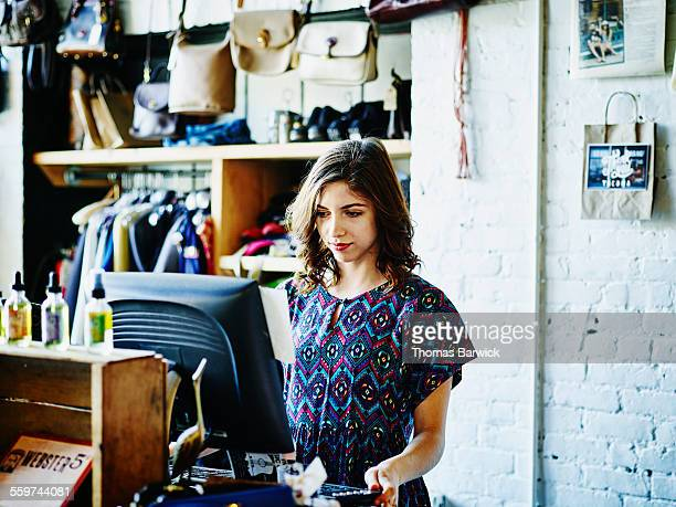Shopkeeper checking inventory in boutique