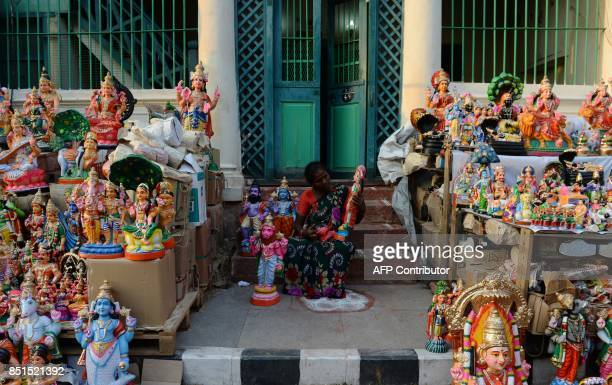 A shopkeeper cleans traditional idols of Gods and characters from the Hindu mythology used as a form of decoration ahead of 'Navarathri' festival...