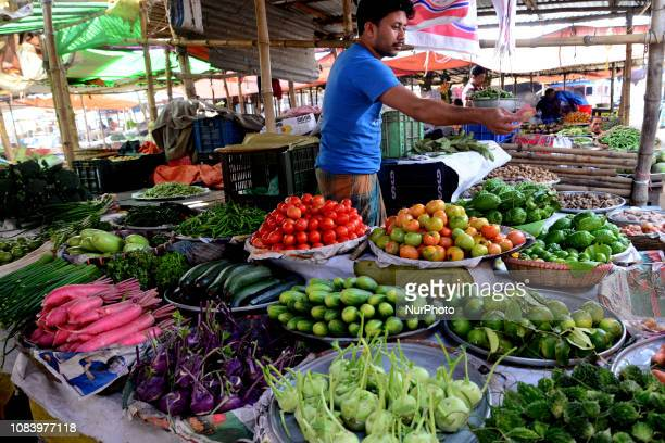 A shopkeeper display different type of vegetables for sale at Nila market Narayanganj district in Bangladesh on January 10 2019 Village market...