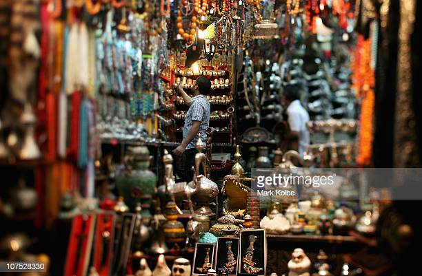 A shopkeeper dusts his stock in his store in the Al Dhalam Souk at Muttrah corniche on December 9 2010 in Muscat Oman The popular tourist shopping...