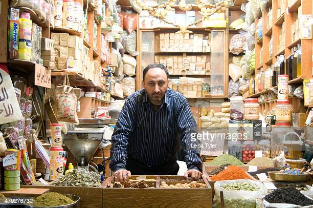 A shopkeeper inside Al Madina Souk in Aleppo Syria before it was destroyed during the civil war Stretching over 12 hectares and dating back to the...