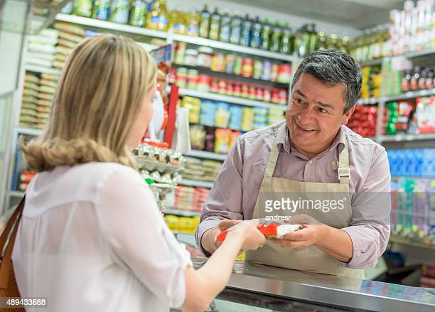 Shopkeeper selling food at his local shop