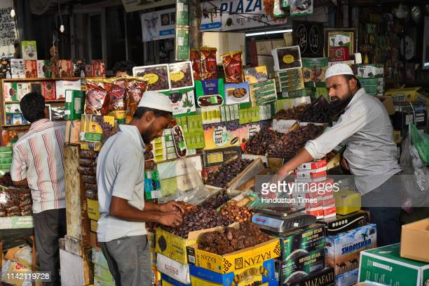 A shopkeeper sells dates on the first day of the holy fasting month of Ramadan at Jama Masjid on May 7 2019 in New Delhi India