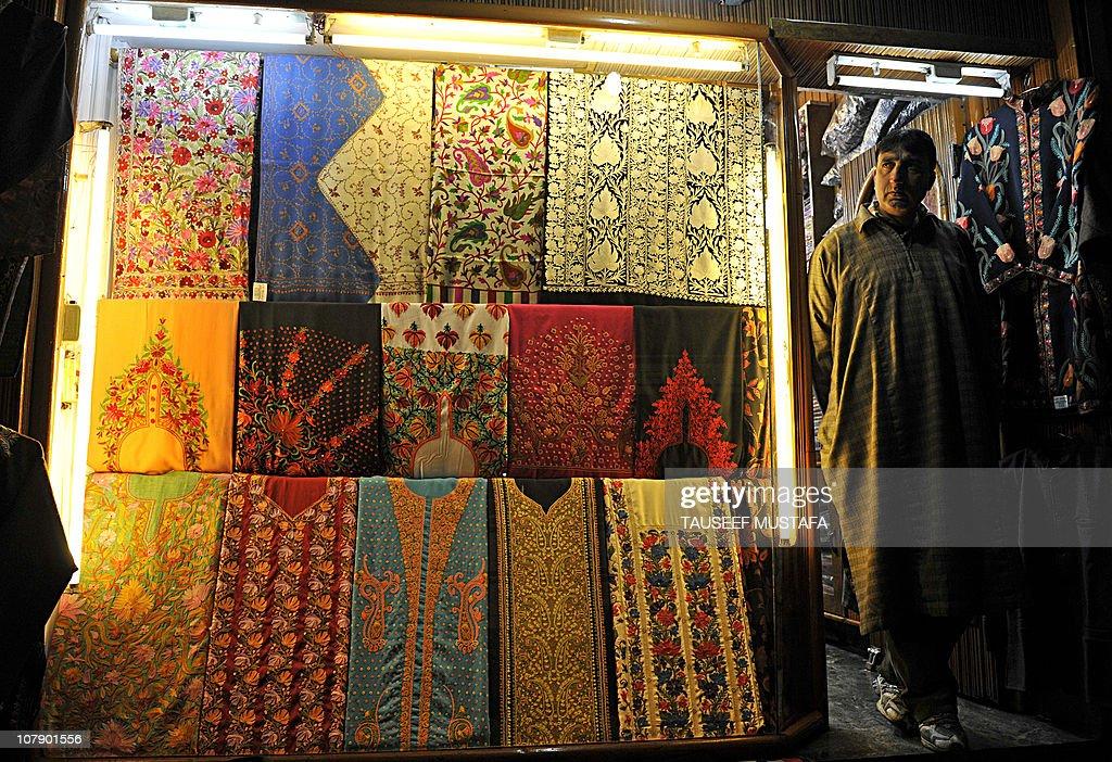A shopkeeper waits for a customer selling Kashmiri shawls in