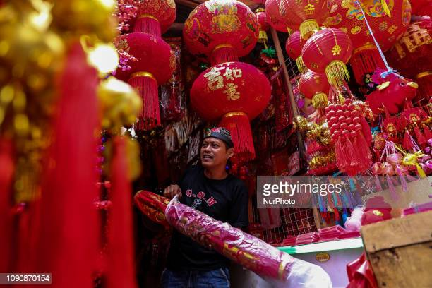 A shopkeeper waits for customers at a shop selling Chinese New Year decorations in the Chinatown in Jakarta Tuesday January 29 2019