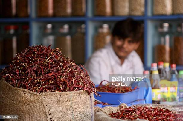 A shopkeeper waits for customers at a spice market in Mumbai on April 28 2008 India's central bank faces a tough dilemma as it decides whether to...