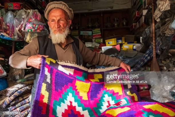 Shopkeeper wearing an Afghan felt beret and a beard on Mai 25, 2016 in Chitral, Khyber Pakhtunkhwa, Pakistan.