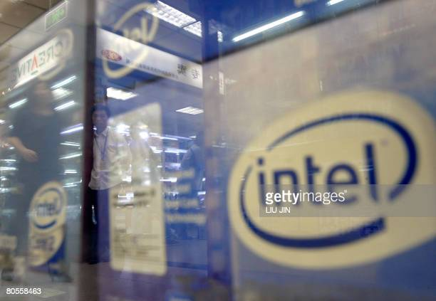 Shopkeepers are reflected on a counter as the Intel products displayed inside at a comupter market in Beijing, on April 08, 2008. The global...