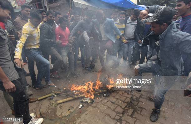 Shopkeepers burn effigy during a nationwide trade bandh today to express solidarity with the families of the CRPF personnel who died in Pulwama...