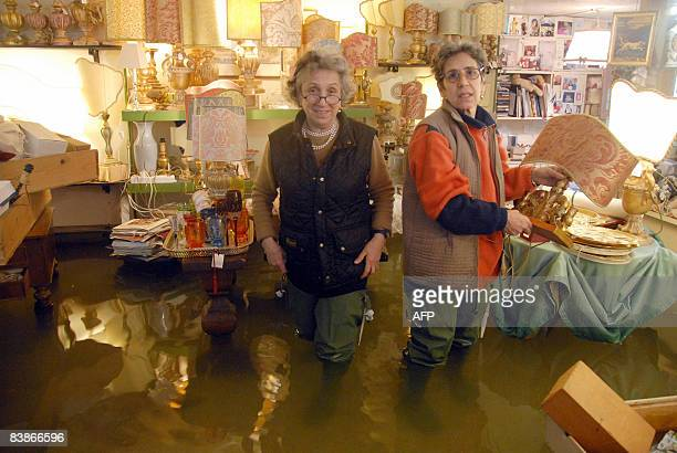 Shopkeepers of an art and antique shop near Piazza San Marco try to save their objects from the flood as water rises in streets of Venice on December...