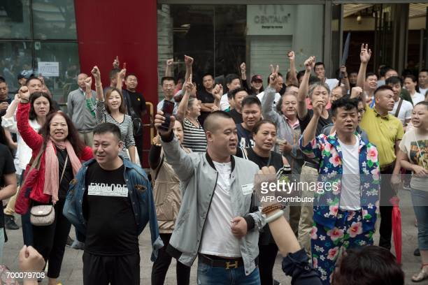 Shopkeepers protest outside the Beijing Zoo wholesale market in Beijing on June 23 2017 Over 100 shopkeepers at a popular Beijing market held a rare...