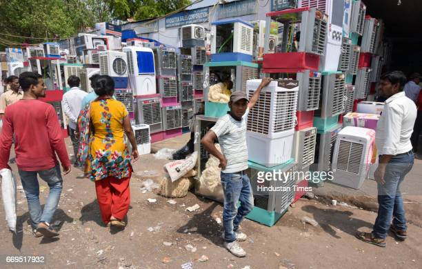 Shopkeepers selling air coolers wait for customers at Kamla Market on April 17 2017 in New Delhi India Delhi residents continued to bear the...