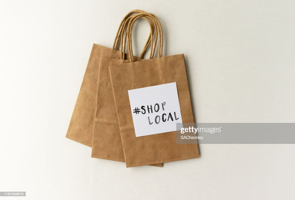 #ShopLocal stamped on a paper bag - shop local message for small retailers / businesses : Stock Photo