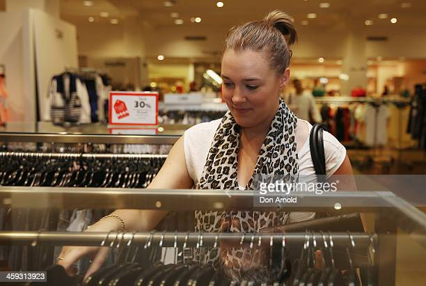 Shopper Alex Roberts checks out the Boxing Day sales at David Jones in its city store on December 26 2013 in Sydney Australia Boxing Day is one of...