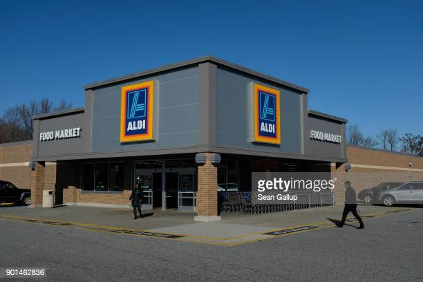 A shopper arrives at an Aldi discount grocery store on December 28 2017 in Edgewood Maryland Aldi which has approximtely 1700 stores across the USA...