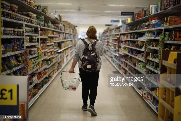 A shopper browses an aisle for groceries at a Tesco Superstore in south London on September 30 2019 Tesco Britain's biggest food retailer will report...