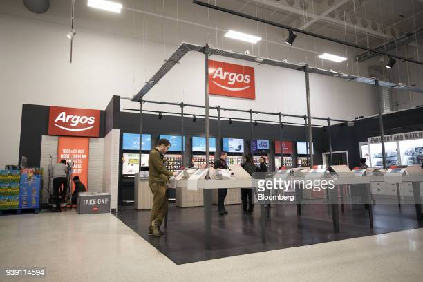 A shopper browses an electronic catalogue at an Argos concession inside a J Sainsbury Plc supermarket in Redhill UK on Tuesday March 27 2018 Mike...