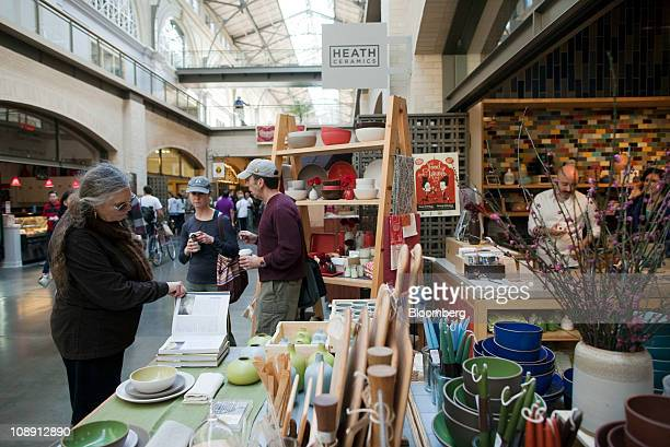 A shopper browses at the Heath Ceramics Ltd store at the Ferry Building in San Francisco California US on Saturday Feb 5 2011 Robin Petravic and his...