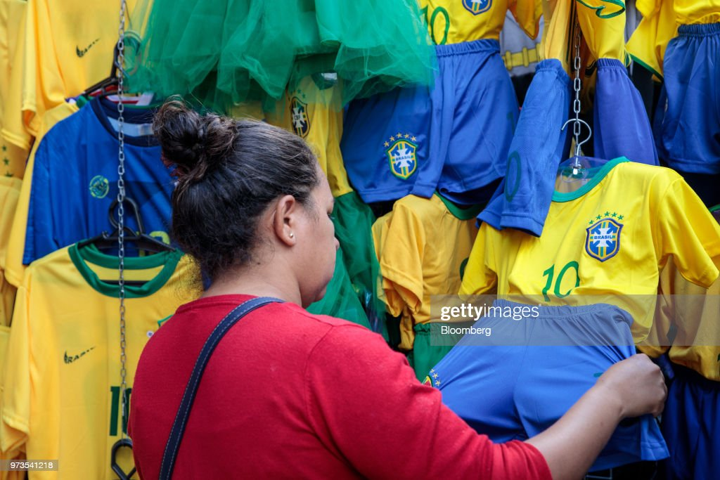 A shopper browses Brazilian themed clothing ahead of the FIFA World Cup games in downtown Sao Paulo, Brazil, on Wednesday, June 13, 2018. In a curious quirk of Brazil's electoral calendar, for the last 28 years Latin America's largest economy has gone to the polls shortly after the World Cup. In the football-obsessed country, politicians have long attempted to hijack the sport to burnish their image. Photographer: Patricia Monteiro/Bloomberg via Getty Images