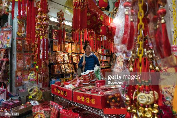 A shopper browses decorations at a store ahead of Lunar New Year in Hong Kong China on Wednesday Feb 14 2018 The city's financial markets will close...