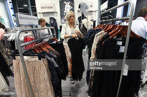 A shopper browses for clothing at a Topshop retail store in London UK on Thursday May 20 2010 Sir Philip Green the billionaire owner of Arcadia Group...