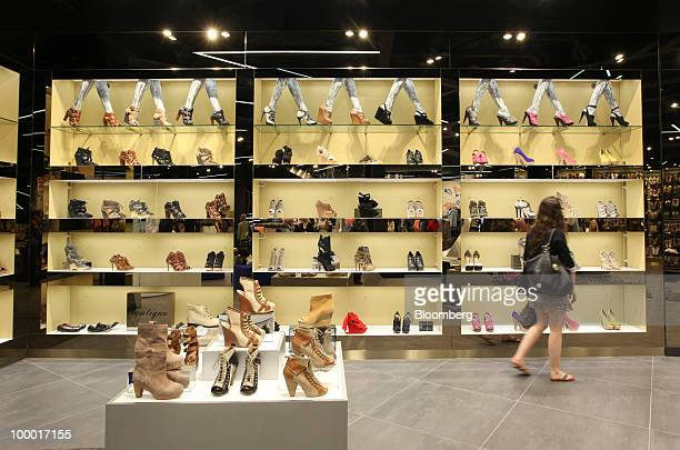 A shopper browses for shoes at a Topshop retail store in London UK on Thursday May 20 2010 Sir Philip Green the billionaire owner of Arcadia Group...