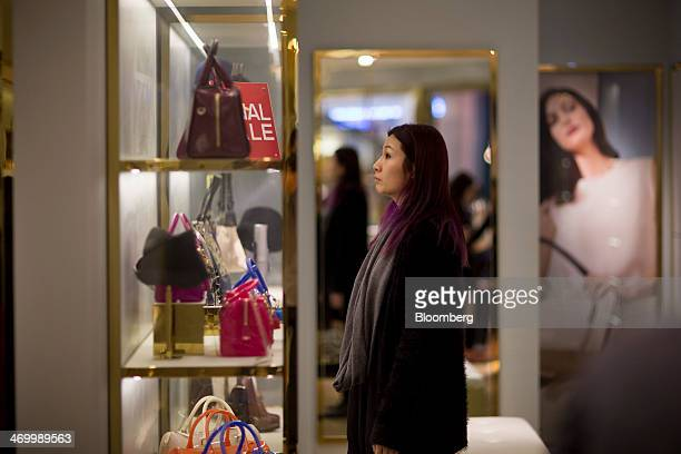 A shopper browses handbags inside a Furla SpA store in Hong Kong China on Thursday Feb 6 2014 Furla the closely held Italian handbag maker predicts...