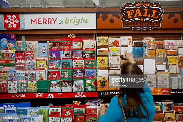 Walmart black friday pictures and photos getty images a shopper browses holiday greeting cards displayed for sale at a walmart stores inc location ahead m4hsunfo