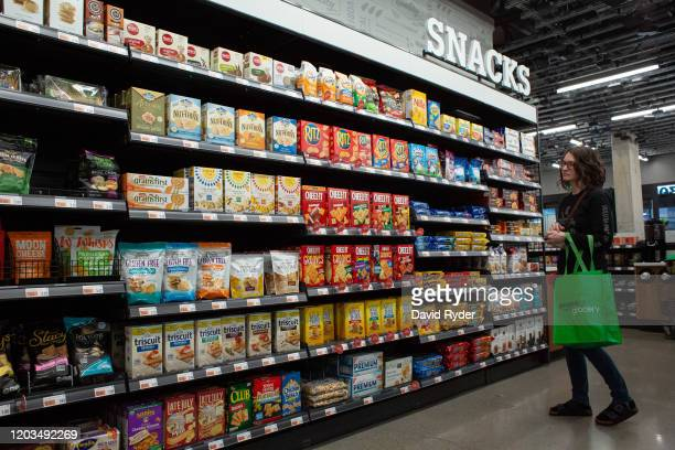 Shopper browses in the snack aisle at Amazon Go Grocery on February 26, 2020 in Seattle, Washington. The store in Seattle's Capitol Hill neighborhood...