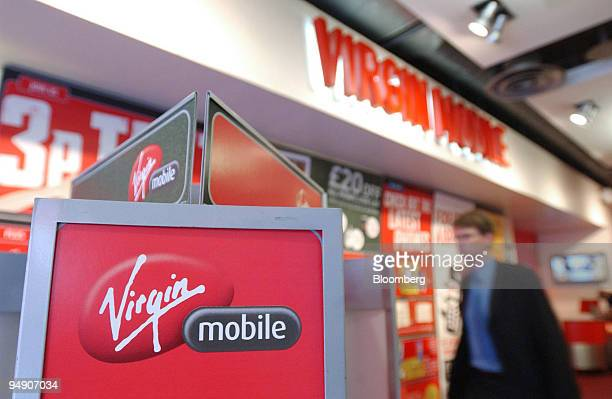 A shopper browses in the Virgin phone store in Piccadilly, London