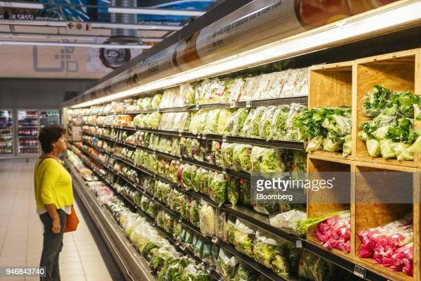 A shopper browses packets of packaged salad leaves inside a Pick n Pay Stores Ltd supermarket in Johannesburg South Africa on Monday April 9 2018 As...
