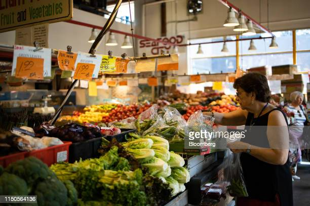 A shopper browses produce at the Granville Island Public Market in Vancouver British Columbia Canada on Sunday June 2 2019 Statistics Canada is...